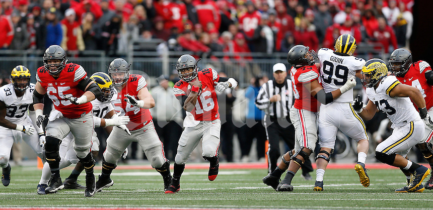Ohio State Buckeyes quarterback J.T. Barrett (16) runs during the fourth quarter of the NCAA football game between the Ohio State Buckeyes and the Michigan Wolverines at Ohio Stadium on Saturday, November 26, 2016. (Columbus Dispatch photo by Jonathan Quilter)