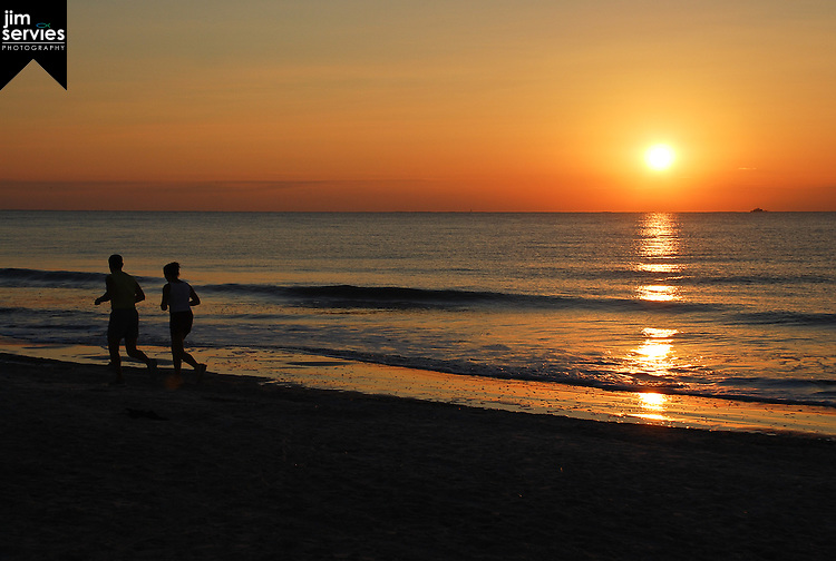 Can't believe I got this one.  A perfect sunrise, a vessel in the distance and a silhoutte of a couple running.  One of my favorite photographs.  Hilton Head, SC