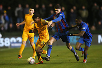 Tristan Abrahams of Newport County and Charlee Hughes of Maldon during Maldon & Tiptree vs Newport County, Emirates FA Cup Football at the Wallace Binder Ground on 29th November 2019