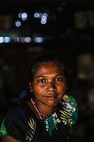 JAIPALGURI, INDIA- AUGUST 16: Player and coach of the female football team, the Dooars XI,  Bhabani Munda, 24, poses for a portrait at the tea stall where she works during the day on August 16, 2013 at the Kalchini tea estate In Jalpaiguri district , West Bengal, India. The Kalchini tea estate where Bhabani Munda lives is one of the most interior and backwards regions in north Bengal. The tea estates of North Bengal, including the Kalchini tea estate, were in news in 2007-08 for large-scale starvation deaths owing to malnutrition. Even today one person dies every day due to starvation in the north Bengal tea estates. In the last decade there have been 3500 deaths in these tea estates. (Photo by Daniel Berehulak for Time Magazine)