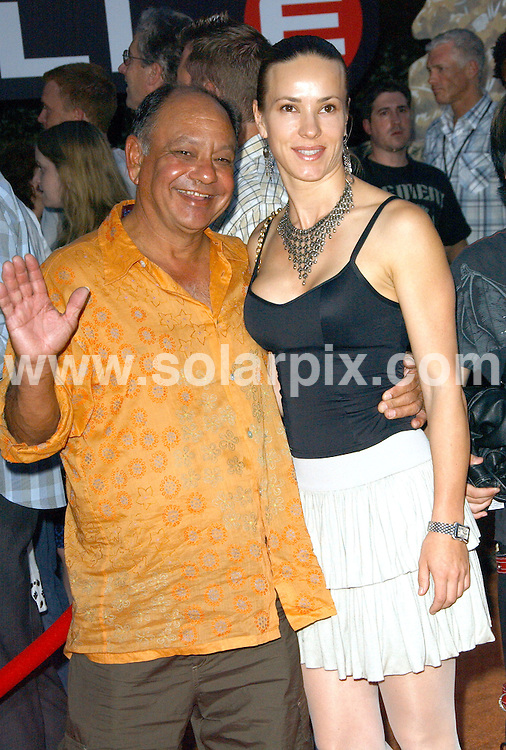 **ALL ROUND PICTURES FROM SOLARPIX.COM**.**SYNDICATION RIGHTS FOR UK, SPAIN, PORTUGAL, AUSTRALIA, S.AFRICA & DUBAI (U.A.E) ONLY**.The  film WALL.E World Premiere at the Greek Theatre in Los Angeles, California in the USA.  .This pic:Cheech Marin with wife..JOB REF:6708-PHZ/Albert L. Ortega    DATE:21_06_08 .**MUST CREDIT SOLARPIX.COM OR DOUBLE FEE WILL BE CHARGED* *UNDER NO CIRCUMSTANCES IS THIS IMAGE TO BE REPRODUCED FOR ANY ONLINE EDITION WITHOUT PRIOR PERMISSION*