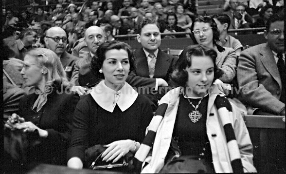 Henrietta Pedrin Gonzales (center), looks on as her husband, Pancho Gonzales, plays Australian Ken Rosewall at Madison Square Garden, New York, 1957. Photo by John G. Zimmerman