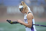 Erica Perrotta (4) of the High Point Panthers inspects her stick prior to the game against the Furman Purple Paladins at Vert Track, Soccer & Lacrosse Stadium on February 10, 2018 in High Point, North Carolina.  The Panthers defeated the Purple Paladins 17-6.  (Brian Westerholt/Sports On Film)