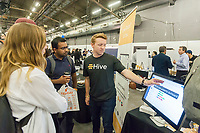 Workers from Hive speak to attendees at the TechDay New York event on Tuesday, April 18, 2017. Thousands attended to seek jobs with the startups and to network with their peers. TechDay bills itself as the U.S.'s largest startup event with over 500 exhibitors. (© Richard B. Levine)