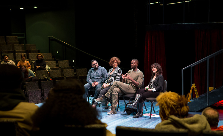 "Left to right, Nathan Singh, director of ""Wig Out!"" and 3rd year MFA Directing student in The Theatre School, Gloria ""Mama Gloria"" Allen, retired nurse and a trans-community activist in Chicago, Tarell Alvin McCraney, playwright of ""Wig Out!"" and Oscar award winning playwright and screenwriter for ""Moonlight,"" and Lisa Portes, head of Directing at The Theatre School, talk with students, faculty and staff from the set of ""Wig Out!"" on the Fullerton Stage in The Theatre School building, Friday, April 21, 2017. (DePaul University/Jeff Carrion)"