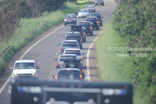 United States President Barack Obama's motorcade travels along Farrington Highway in Wailua, Oahu, Hawaii on their way to the Presidents schoolmate Bobby Titcomb's beach house in Wailua, Hawaii on Thursday, December 30, 2010.  Wailua, Oahu. .Credit: Cory Lum / Pool via CNP