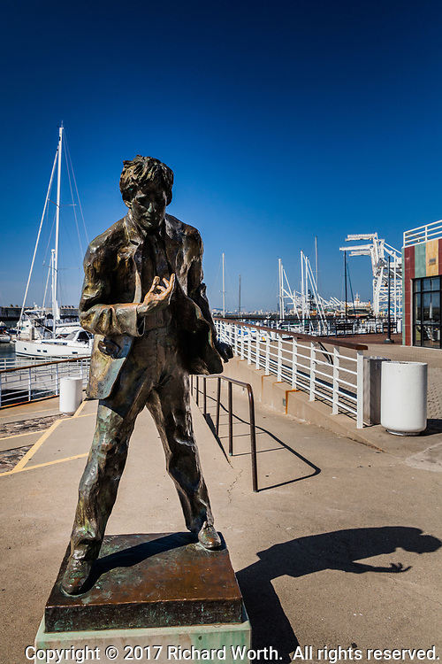 The monument to Jack London casts its shadow at Jack London Square on Oakland's bay shoreline.  The statue was created by San Francisco artist Cedric Wentworth