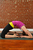 Young woman doing yoga stock photo
