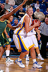 BROOKINGS, SD - NOVEMBER 23rd, 2008 : South Dakota State's Jennifer Warkenthien drives in to the basket while being guarded by Oregon defender Lindsey Saffold during their game Sunday afternoon at Frost Arena on the campus of South Dakota State University in Brookings, SD. (Photo By Ty Carlson/Inertia)