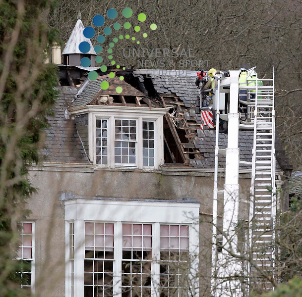Fire-fighters look over the 13th century Kelburn Castle after a blaze took hold at 1.45am. It was reported that Lord Glasgow and other family members were led to safety as Strathclyde fire-fighters tackled the fire..Picture: Universal News and Sport - 16/02/2009............. ........... .