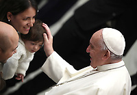 Papa Francesco benedice una bambina  al termine dell'udienza Generale del mercoledi' in aula Paolo VI in Vaticano, 9 gennaio 2019.<br /> Pope Francis blesses a child at the end of his weekly general audience in Paul VI Hall at the Vatican, on January, 2019.<br /> UPDATE IMAGES PRESS/Isabella Bonotto<br /> <br /> STRICTLY ONLY FOR EDITORIAL USE