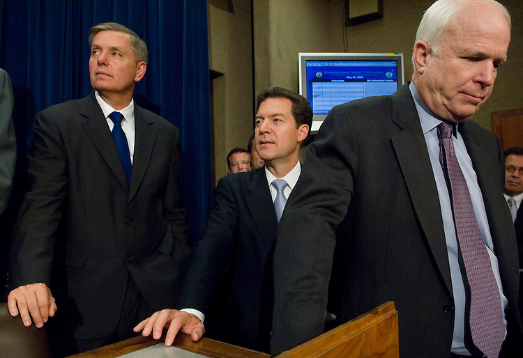 05/25/06--Sen. Lindsey Graham, R-S.C., Sen. Sam Brownback, R-Kan., Sen. John McCain, R-Ariz., and other senators during a news conference after the Senate passed, 62-36, a sweeping immigration overhaul Thursday evening, setting up what is likely to be a bruising battle with the House over the fate of 11 million to 12 million illegal immigrants already in the United States. The compromise measure (S 2611) would grant most of those immigrants legal status to work in the United States and allow them to earn U.S. citizenship over a period of years. That provision, denounced as ÒamnestyÓ by bill opponents, is anathema to most House Republicans and will make for a contentious conference. Congressional Quarterly Photo by Scott J. Ferrell
