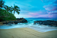 Secluded beach with palm trees and sunrise. Maui, Hawaii