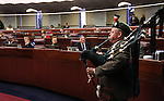 Former Nevada Senator Dennis Nolan plays the bagpips on the Assembly floor at the Legislature in Carson City, Nev., on Thursday, March 17, 2011..Photo by Cathleen Allison