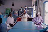 Salalah, Oman.July 2001..Watching a foot ball game in a small deli.