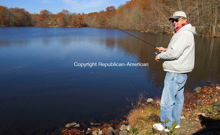 WATERBURY, CT. 03 November 2010-110310SV05--Ben Finnemore of Watertown enjoys a warm fall day fishing at Lakewood pond in Waterbury Wednesday.<br /> Steven Valenti Republican-American