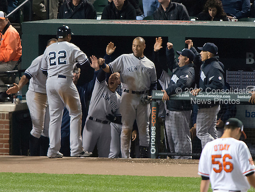 New York Yankees left fielder Andruw Jones (22) celebrates with his teammates after hitting a home run in the sixth inning against the Baltimore Orioles at Oriole Park at Camden Yards in Baltimore, MD on Monday, April 9, 2012.  The Yankees won the game  6 - 2..Credit: Ron Sachs / CNP.(RESTRICTION: NO New York or New Jersey Newspapers or newspapers within a 75 mile radius of New York City)