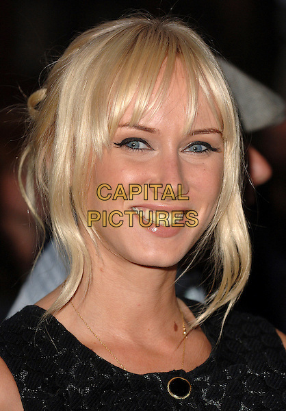 "KIMBERLY STEWART.attending the UK premiere of the third chapter in the Jason Bourne saga ""The Bourne Ultimatum"",.Odeon Leicester Square, London,15th August 2007..portrait headshot fringe Kimberley.CAP/ BEL.©Tom Belcher/Capital Pictures."