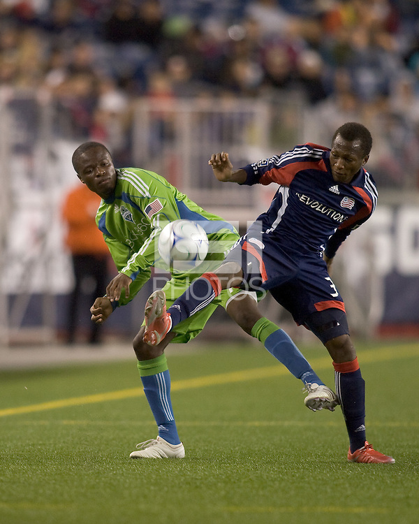 Seattle Sounders forward Steve Zakuani (11) and New England Revolution midfielder Sainey Nyassi (31) battle for the ball. The New England Revolution defeated Seattle Sounders, 2-1, at Gillette Stadium on September 26, 2009.