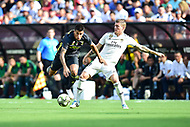 Landover, MD - August 4, 2018: Juventus F.C. Cavaco Cancelo defender and Real Madrid midfielder Toni Kroos (8) fight for the ball during the match between Juventus and Real Madrid at FedEx Field in Landover, MD. (Photo by Phillip Peters/Media Images International)