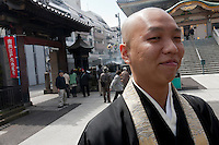 Monks at  Shinshoji Temple, Sugamo, Tokyo, Japan Wednesday, April 14th 2010. Sugamo is affectionately known as the old lady Harajuku, in reference to the Mecca for youth fashions in the South of Tokyo, and is a popular place for Tokyo's increasingly aged population.