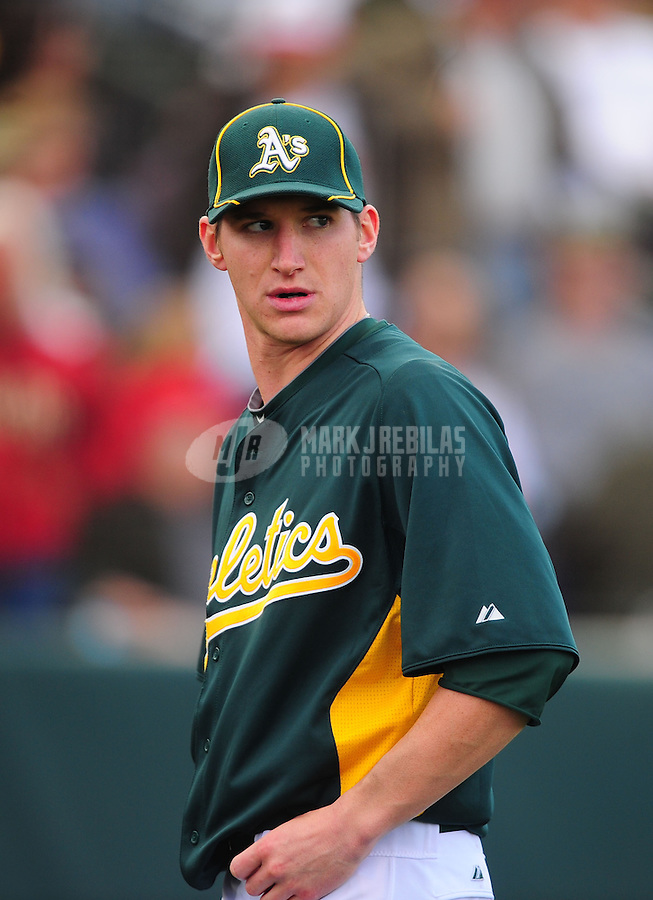 Mar. 19, 2012; Phoenix, AZ, USA; Oakland Athletics pitcher Jarrod Parker after being pulled from the game in the fourth inning against the Arizona Diamondbacks during a spring training game at Phoenix Municipal Stadium.  Mandatory Credit: Mark J. Rebilas-