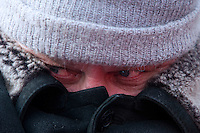 Moscow, Russia, 04/02/2012..A protester wrapped against the cold as tens of thousands of demonstrators marched and protested against election fraud and Prime Minister Vladimir Putin in temperatures of -20 centigrade. Organisers claimed an attendance of 130,000 despite the bitter cold.