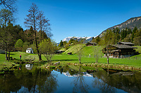 Austria, Tyrol, Kramsach: open-air museum Tyrolean Farmhouses - pond and 'Summerau' farmhouse at early spring | Oesterreich, Tirol, Wanderdorf Kramsach: Freilichtmuseum Tiroler Bauernhoefe - Weiher und Summerau Hof zu Fruehlingsanfang
