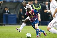 MILANO 28 MARZO 2012, MILAN - BARCELLONA,QUARTI DI FINALE UEFA CHAMPIONS LEAGUE 2011 - 2012, NELLA FOTO:MESSI E SEEDORF , FOTO DI ROBERTO TOGNONI.
