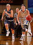 BROOKINGS, SD - OCTOBER 30:  Megan Waytashek #24 from South Dakota State University pushes the ball up court past Jordan Needens #14 from South Dakota School of Mines in the first half of their exhibition game Thursday night at Frost Arena in Brookings. (Photo by Dave Eggen/Inertia)