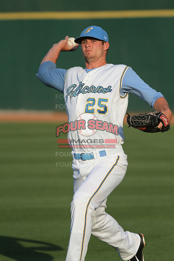 Myrtle Beach Pelicans pitcher Randy Henry #25 throwing in the outfield before a game against the Frederick Keys at Tickerreturn.com Field at Pelicans Ballpark on April 25, 2012 in Myrtle Beach, South Carolina. Myrtle Beach defeated Frederick by the score of 3-1. (Robert Gurganus/Four Seam Images)