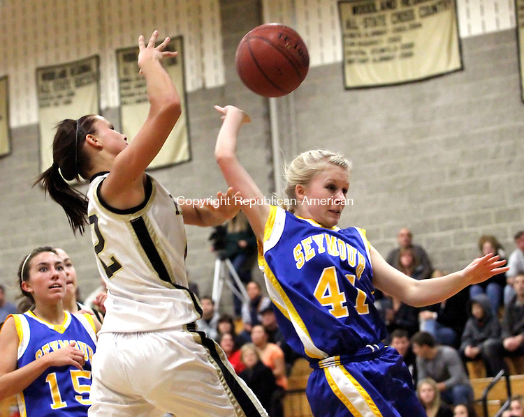 Beacon Falls, CT- 10, December 2010-121010CM15  Seymour's Hannah Saffo fouls Woodland's Kate Tuckey (left) as she goes up for a layup during the first second quarter Friday night in Beacon Falls.  Woodland defeated Seymour, 57-54.     Christopher Massa Republican-American