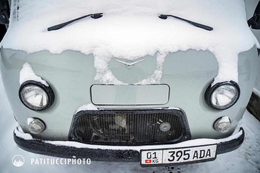 A snow covered UAZ 452 in Kyrgyzstan
