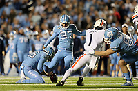 CHAPEL HILL, NC - NOVEMBER 02: Noah Ruggles #97 of the University of North Carolina kicks a field goal during a game between University of Virginia and University of North Carolina at Kenan Memorial Stadium on November 02, 2019 in Chapel Hill, North Carolina.