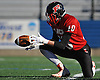 Plainedge No. 10 Nicholas Checchia takes the snap on a successful PAT attempt in the first quarter of the Nassau County varsity football Conference III final against Plainedge at Hofstra University on Saturday, Nov. 21, 2015.<br /> <br /> James Escher