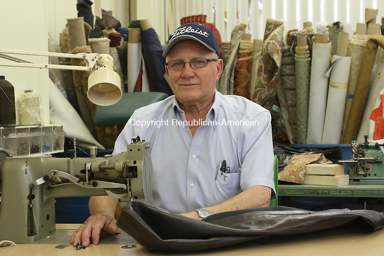 WATERTOWN, CT, 10 June 2015 - 061015LW02 - Ron Plourde works on the sewing machine he's owned for 40 years at his new shop, Upholstery by Ron/ Fredricks at 737 Main St. in Watertown. Laraine Weschler Republican-American