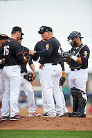 Quad Cities River Bandits manager Omar Lopez (43) makes a pitching change to Ryan Deemes (16) as Aaron Mizell, Connor Goedert, and catcher Christian Correa look on during a game against the Burlington Bees on May 9, 2016 at Modern Woodmen Park in Davenport, Iowa.  Quad Cities defeated Burlington 12-4.  (Mike Janes/Four Seam Images)