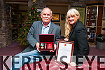 Fiona Corcoran from the Greater Chernobyl Cause and charity sponsor Brian De Staic (Dingle) showing the medals and certificate the charity received from the Russian Authorities for its work.