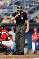 Umpire Justin Houser during a game between the Staten Island Yankees and Batavia Muckdogs on August 7, 2014 at Dwyer Stadium in Batavia, New York.  Staten Island defeated Batavia 2-1.  (Mike Janes/Four Seam Images)