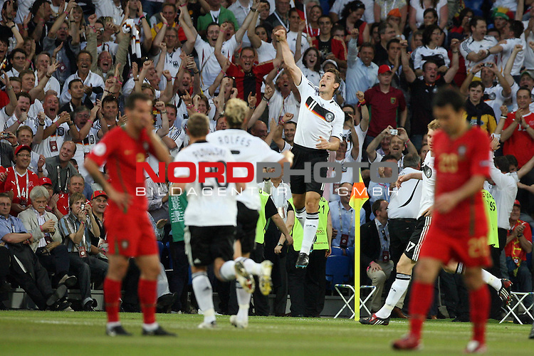 UEFA Euro 2008 Quarter-Finals Match 25 Basel - St. Jakob-Park. Portugal ( POR ) - Deutschland ( GER ). <br /> Torsch&uuml;tze Miroslav Klose ( Germany / Angreifer / Forward / Bayern Muenchen #11 ) (M rechts) feiert seinen Treffer zum 2:0. Die Portugiesen zeigen sich entt&auml;uscht.<br /> Foto &copy; nph (  nordphoto  )