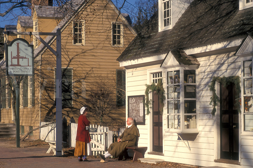 Colonial Williamsburg, Virginia, VA, Williamsburg, Interpreters wearing colonial costumes talk outside the village post office in Colonial Williamsburg.