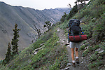 Backpacker climbing the Venable-Comanche trail, Sangre de Cristo Wilderness, San Isabel National Forest, Colorado