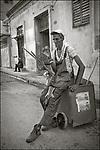 Santiago de Cuba, Oriente, Cuba:<br /> Street scene, street sweeper