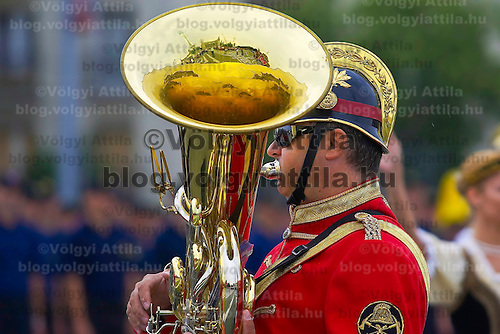 Heroes square is reflected on the instrument of a firefighter musician during the inauguration of firemen held at Heroes Square.