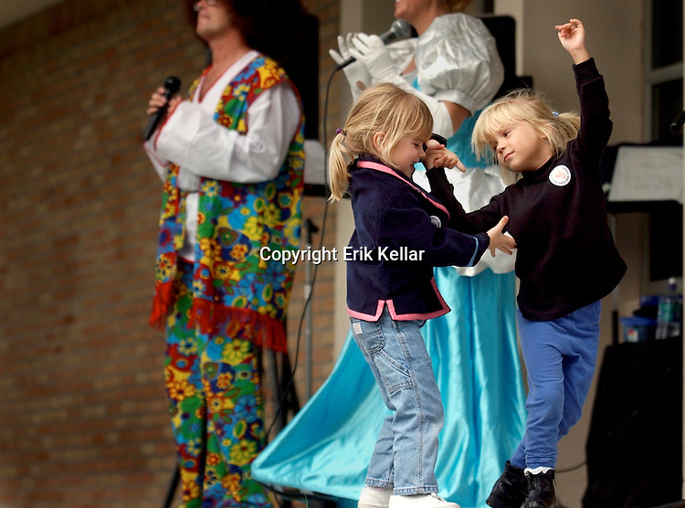 Two girls dane to music during a fall festival on Marco Island Florida. Erik Kellar