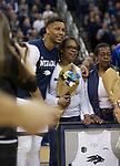 Nevada's Tre'Shawn Thurman poses for photos with his family on during senior night before an NCAA college basketball game against San Diego State in Reno, Nev., Saturday, March 9, 2019. (AP Photo/Tom R. Smedes)