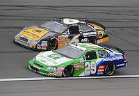 Oct. 3, 2009; Kansas City, KS, USA; NASCAR Nationwide Series driver Clint Bowyer (29) races alongside Erik Darnell during the Kansas Lottery 300 at Kansas Speedway. Mandatory Credit: Mark J. Rebilas-