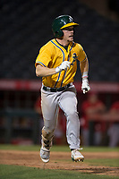 AZL Athletics second baseman Nick Ward (4) hustles down the first base line during an Arizona League game against the AZL Angels at Tempe Diablo Stadium on June 26, 2018 in Tempe, Arizona. The AZL Athletics defeated the AZL Angels 7-1. (Zachary Lucy/Four Seam Images)