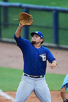 Dunedin Blue Jays first baseman Rowdy Tellez (8) stretches for a throw during a game against the Charlotte Stone Crabs on July 26, 2015 at Charlotte Sports Park in Port Charlotte, Florida.  Charlotte defeated Dunedin 2-1 in ten innings.  (Mike Janes/Four Seam Images)