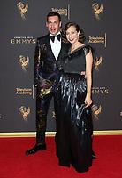 LOS ANGELES, CA - SEPTEMBER 09: John Roberts, Kristen Schaal, at the 2017 Creative Arts Emmy Awards at Microsoft Theater on September 9, 2017 in Los Angeles, California. <br /> CAP/MPIFS<br /> &copy;MPIFS/Capital Pictures